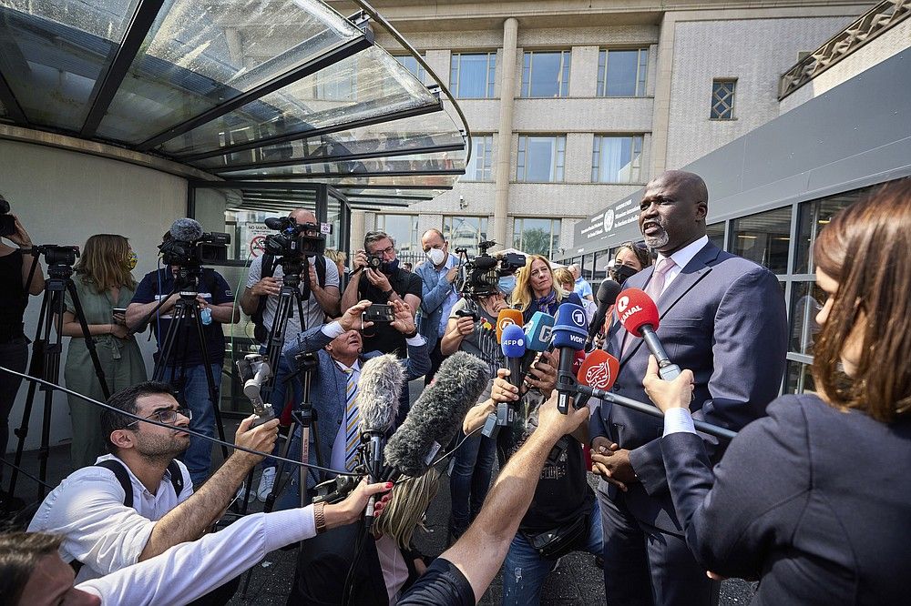 Abubacarr Tambadou, the Registrar of the International Residual Mechanism for Criminal Tribunals, speaks to journalists outside the court in The Hague, Netherlands, Tuesday, June 8, 2021. U.N. appeals judges on Tuesday upheld the conviction of former Bosnian Serb military chief Ratko Mladic for genocide and other offenses during Bosnia's 1992-95 war and confirmed his life sentence. (AP Photo/Phil Nijhuis)
