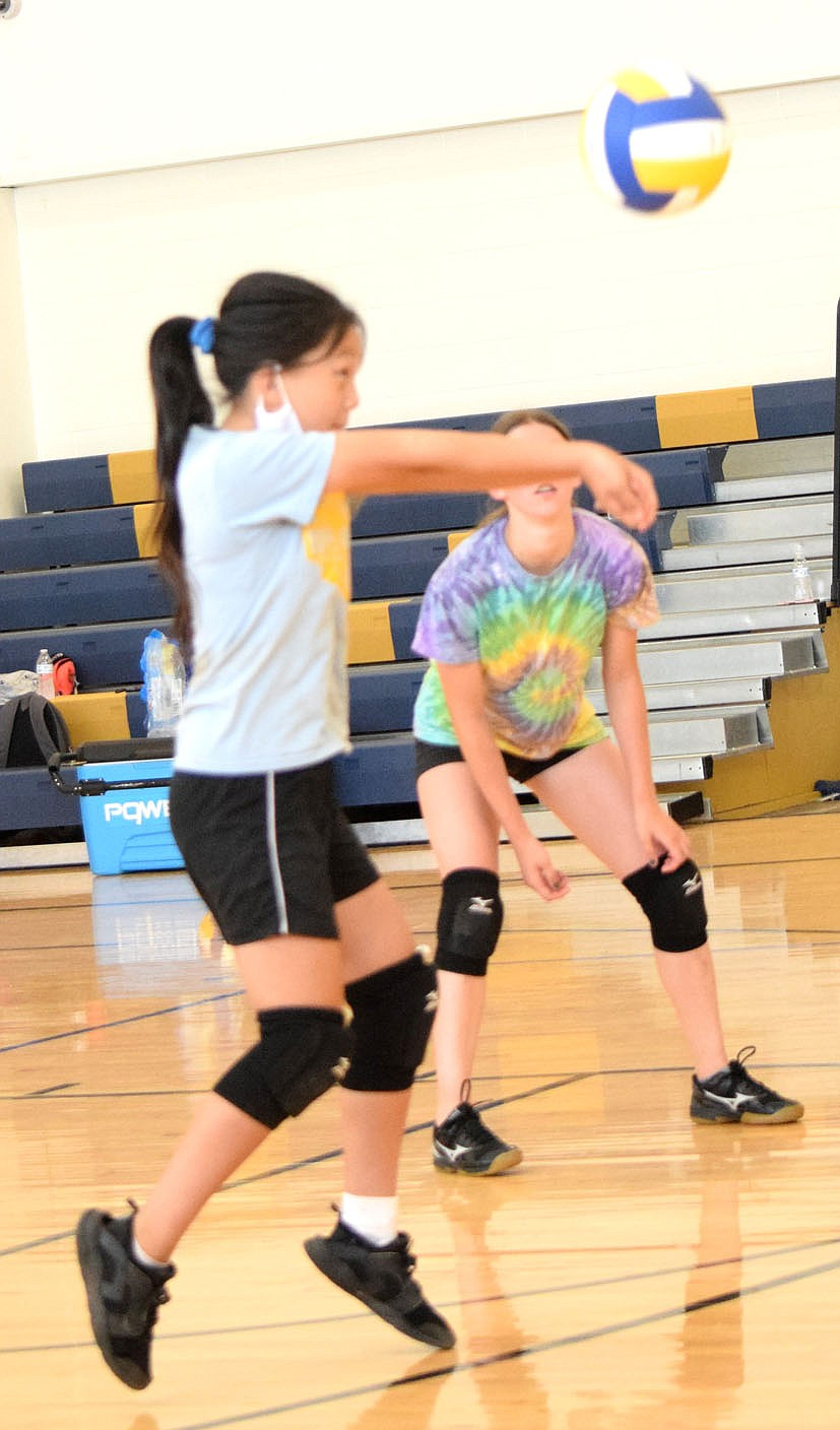 Westside Eagle Observer/MIKE ECKELS Anna Xiong uses a forearm pass to send the ball back over the net during the June 9 Lady Bulldog junior high volleyball practice in the gym at Decatur Middle School.