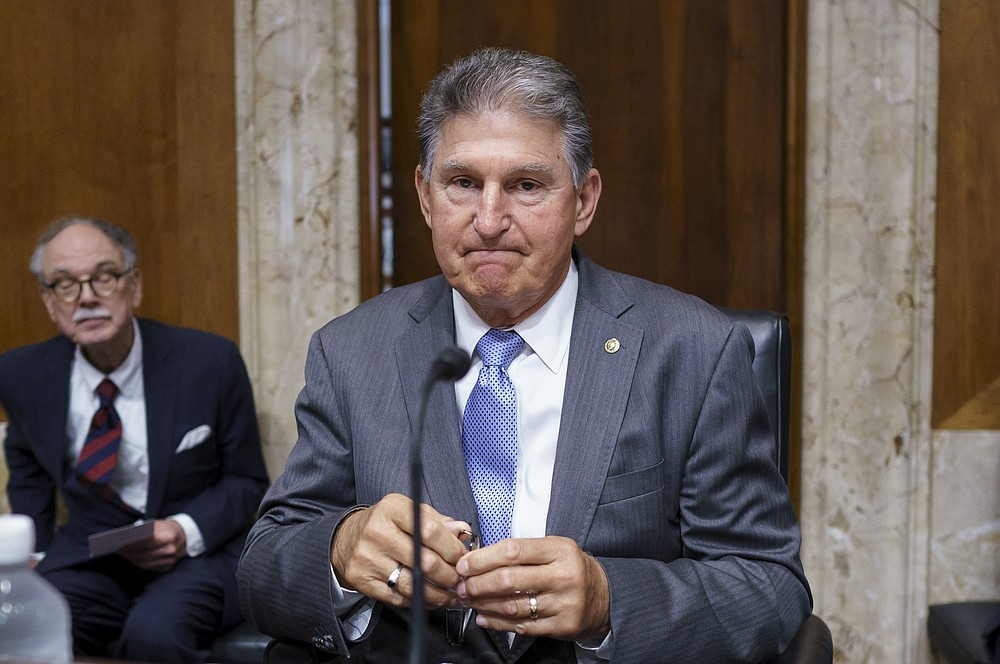 Sen. Joe Manchin, D-W.Va., chairman of the Senate Energy and Natural Resources Committee, arrives for a hearing at the Capitol in Washington, Tuesday, June 8, 2021. Manchin, a crucial 50th vote for his party on President Joe Biden's proposals, said Sunday he would vote against federal voting rights legislation sponsored by his own party. (AP Photo/J. Scott Applewhite)