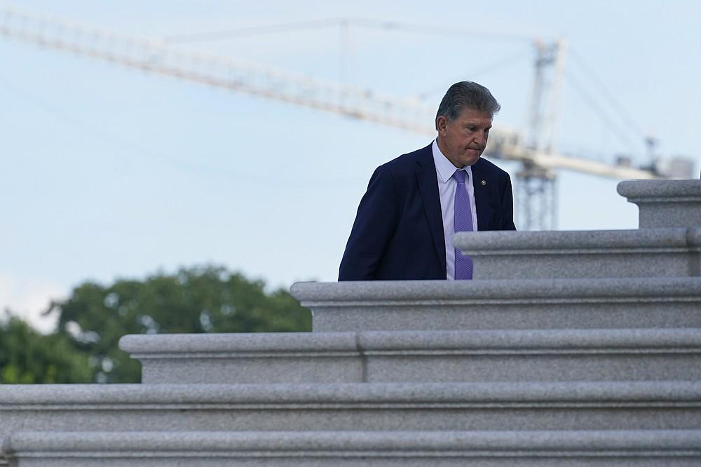 Sen. Joe Manchin, D-W.Va., walks up the steps of Capitol Hill in Washington, Monday, June 7, 2021. (AP Photo/Susan Walsh)