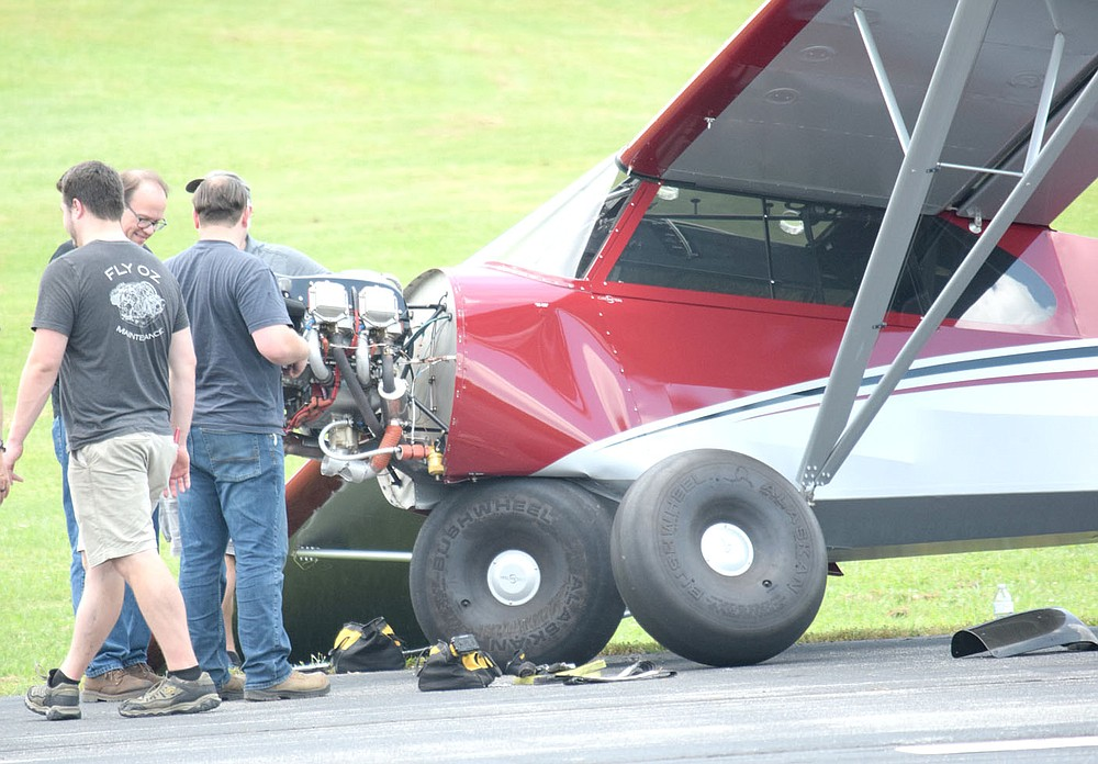Westside Eagle Observer/MIKE ECKELS  The extent of the damage to a Cubcrafter CC11-150 Carbon Cub SS aircraft is clearly visible after the plane made a hard landing on runway 13 at Crystal Lake Airport June 9. The right wing sustained damage after striking the ground when the plane came to rest. The right main landing gear folded up under the front fuselage.