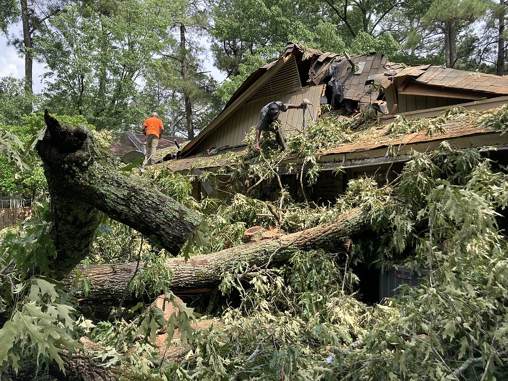 A second tree fell on this Cherry Street home on Tuesday, a day after a first large oak crushed the other end of the house. (Pine Bluff Commercial/Byron Tate)