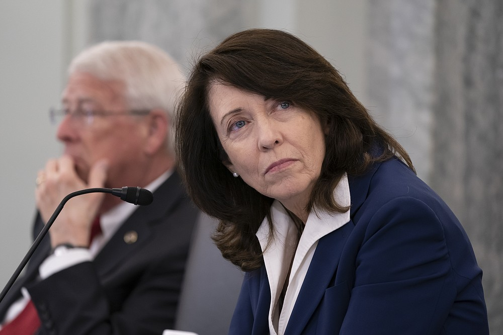 Sen. Maria Cantwell, D-Wash., chair of the Senate Commerce, Science, and Transportation Committee, joined at left by Sen. Roger Wicker, R-Miss., holds a hearing on student athlete compensation and federal legislative proposals to enable athletes participating in collegiate sports to monetize their name, image, and likeness, at the Capitol in Washington, Wednesday, June 9, 2021. (AP Photo/J. Scott Applewhite)