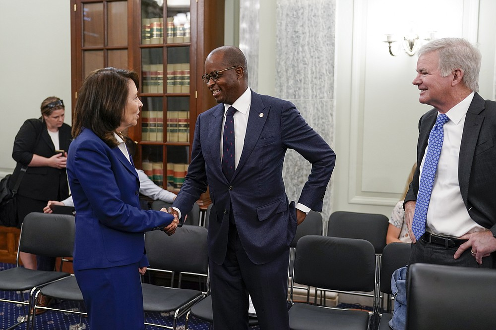 Sen. Maria Cantwell, D-Wash., chair of the Senate Commerce, Science, and Transportation Committee, left, greets Howard University President Wayne A. I. Frederick, center, and NCAA President Mark Emmert, as her panel holds a hearing on student athlete compensation and federal legislative proposals to enable athletes participating in collegiate sports to monetize their name, image, and likeness, at the Capitol in Washington, Wednesday, June 9, 2021. (AP Photo/J. Scott Applewhite)