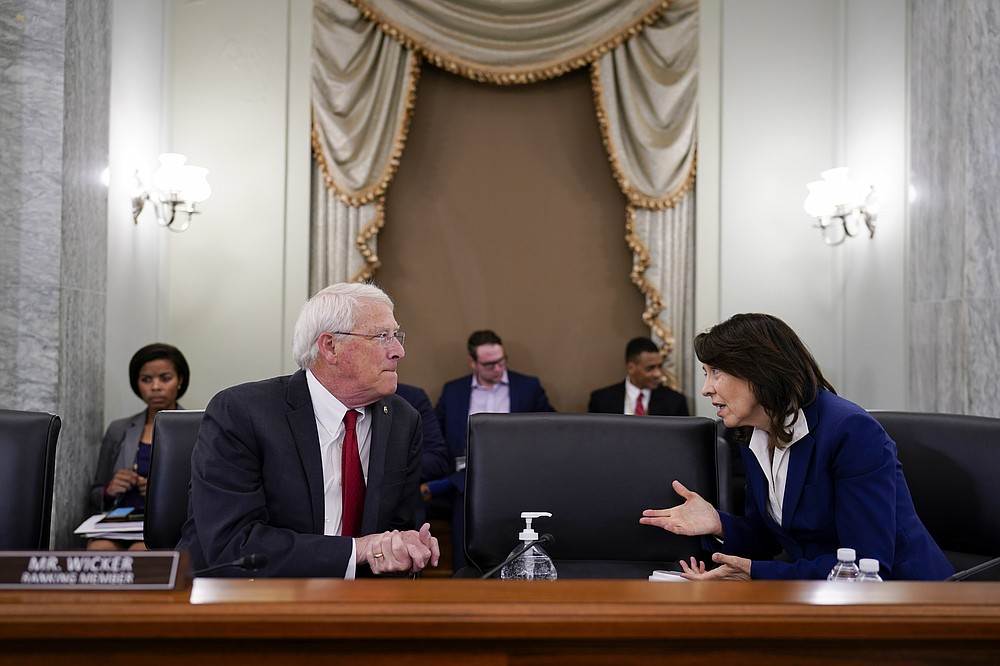 Sen. Roger Wicker, R-Miss., left, and Sen. Maria Cantwell, D-Wash., chair of the Senate Commerce, Science, and Transportation Committee, prepare to hold a hearing on student athlete compensation and federal legislative proposals to enable athletes participating in collegiate sports to monetize their name, image, and likeness, at the Capitol in Washington, Wednesday, June 9, 2021. (AP Photo/J. Scott Applewhite)
