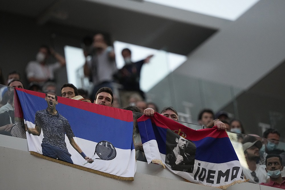 Tennis lovers support Serbia's Novak Djokovic playing Italy's Matteo Berrettini during their quarterfinal match of the French Open tennis tournament at the Roland Garros stadium Wednesday, June 9, 2021 in Paris. (AP Photo/Michel Euler)