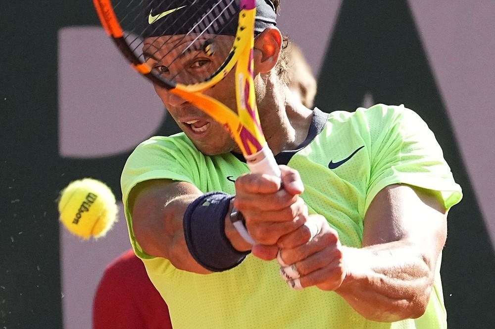 Spain's Rafael Nadal returns the ball to Argentina's Diego Schwartzman during their quarterfinal match of the French Open tennis tournament at the Roland Garros stadium Wednesday, June 9, 2021 in Paris. (AP Photo/Michel Euler)