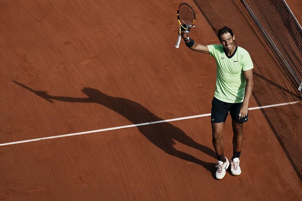 Spain's Rafael Nadal waves after defeating Argentina's Diego Schwartzman in their quarterfinal match of the French Open tennis tournament at the Roland Garros stadium Wednesday, June 9, 2021 in Paris. (AP Photo/Thibault Camus)