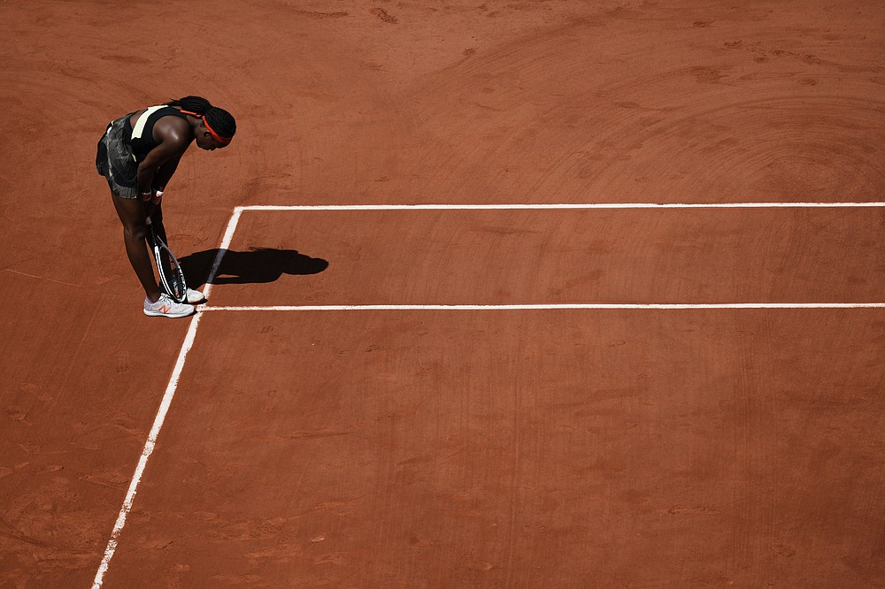United States's Coco Gauff reacts on the court as she plays Czech Republic's Barbora Krejcikova during their quarterfinal match of the French Open tennis tournament at the Roland Garros stadium Wednesday, June 9, 2021 in Paris. (AP Photo/Thibault Camus)