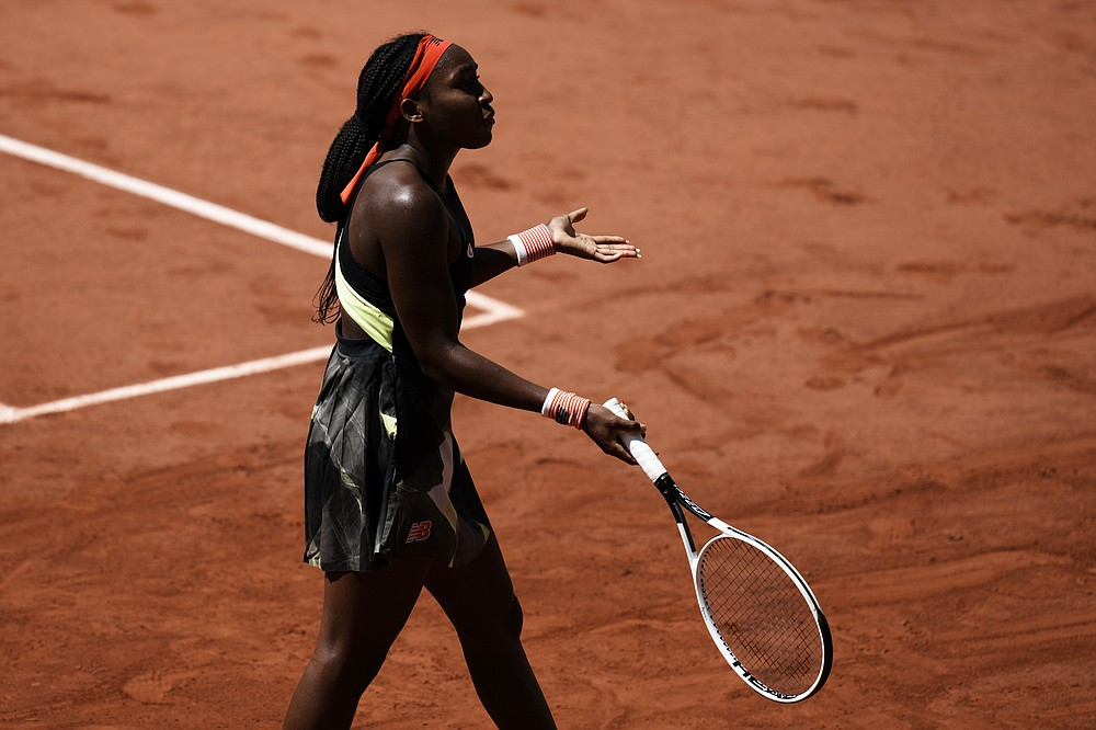 United States's Coco Gauff reacts as she plays Czech Republic's Barbora Krejcikova during their quarterfinal match of the French Open tennis tournament at the Roland Garros stadium Wednesday, June 9, 2021 in Paris. (AP Photo/Thibault Camus)