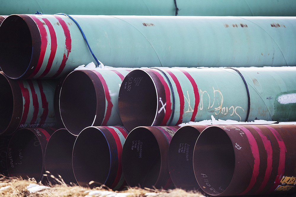 FILE - In this Dec. 18, 2020, file photo, pipes to be used for the Keystone XL pipeline are stored in a field near Dorchester, Neb. Calgary-based TC Energy, sponsor of the Keystone XL crude oil pipeline, said Wednesday, June 9, 2021, that it was pulling the plug on the contentious project after Canadian officials failed to convince President Joe Biden to reverse its cancellation of its permit on the day he took office. (Chris Machian/Omaha World-Herald via AP, FIle))