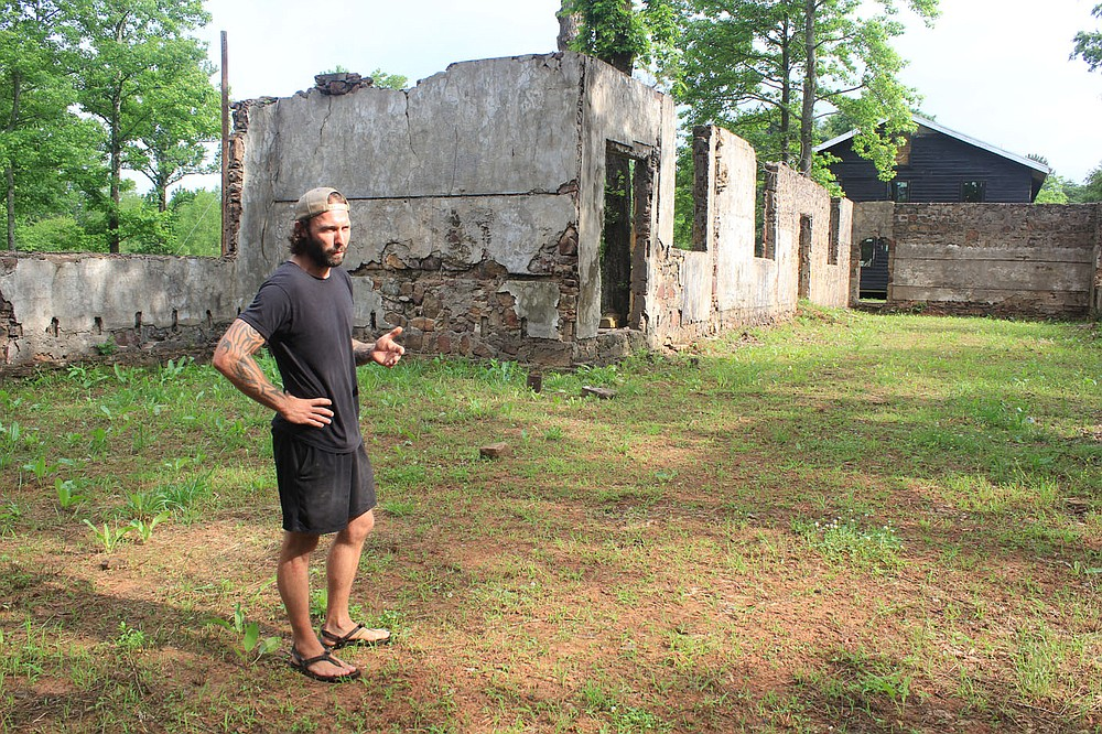 Tom Black of Natural State Renovations shows the ruins of a historic schoolhouse in Rudy he's developing into the Old School Venue on June 9, 2021, on Old School Way. The ruins will function as an outdoor wedding venue.
