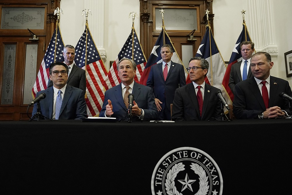 Texas Governor Greg Abbott, seated second from left, speaks at a press conference where he signed two energy-related bills on Tuesday, June 8, 2021, in Austin, Au Texas.  Abbot enacted legislation to reform the Electric Reliability Council of Texas (ERCOT) and alter and improve the reliability of the state's electricity grid.  (AP Photo / Eric Gay)