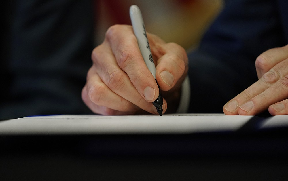 Texas Governor Greg Abbott signs one of two energy bills on Tuesday, June 8, 2021, in Austin, Texas.  Abbot enacted legislation to reform the Electric Reliability Council of Texas (ERCOT) and alter and improve the reliability of the state's electricity grid.  (AP Photo / Eric Gay)