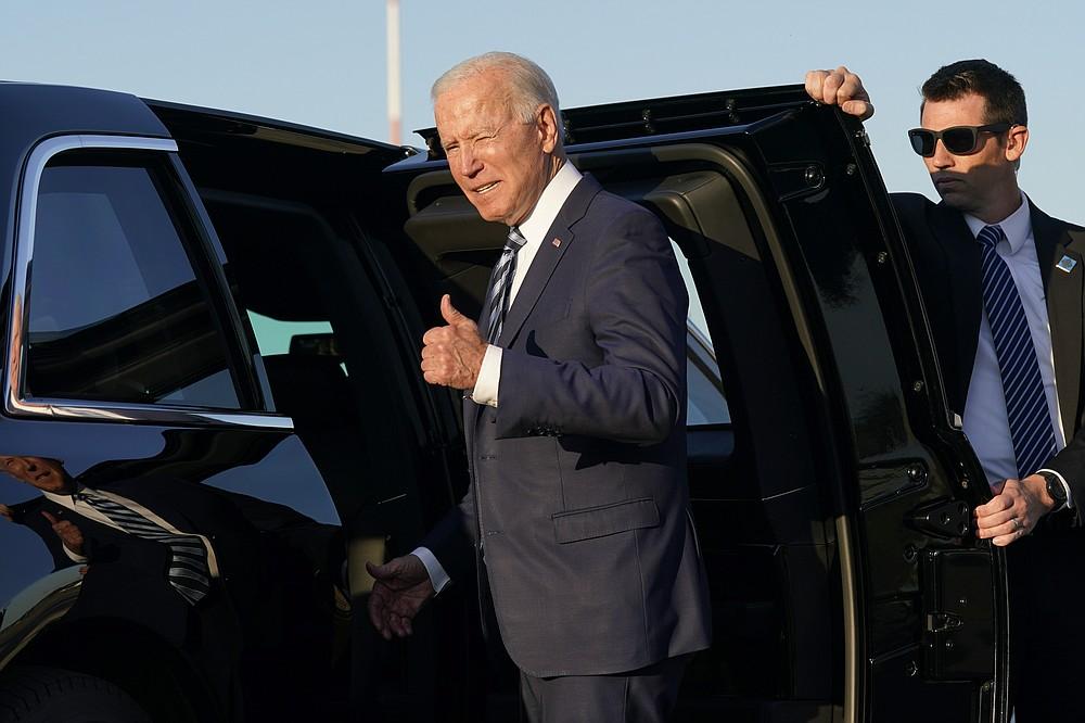 President Joe Biden steps into a motorcade vehicle after arriving at RAF Mildenhall in Suffolk, England, Wednesday, June 9, 2021. (AP Photo/Patrick Semansky)