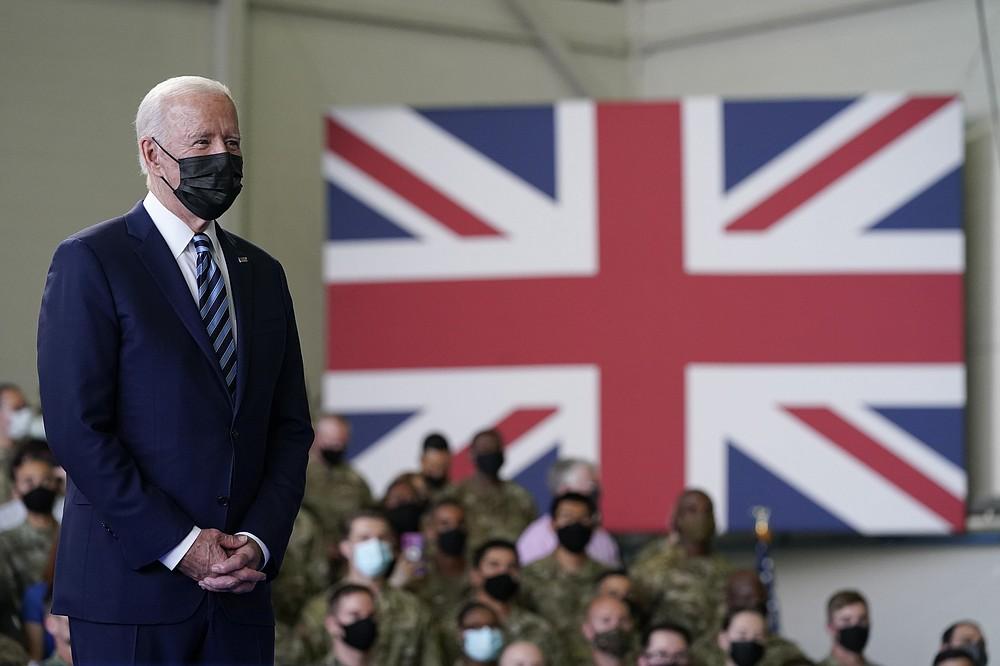 President Joe Biden listens as first lady Jill Biden speaks to American service members at RAF Mildenhall in Suffolk, England, Wednesday, June 9, 2021. (AP Photo/Patrick Semansky)