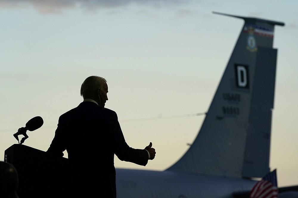 President Joe Biden gestures as he speaks to American service members at RAF Mildenhall in Suffolk, England, Wednesday, June 9, 2021. (AP Photo/Patrick Semansky)