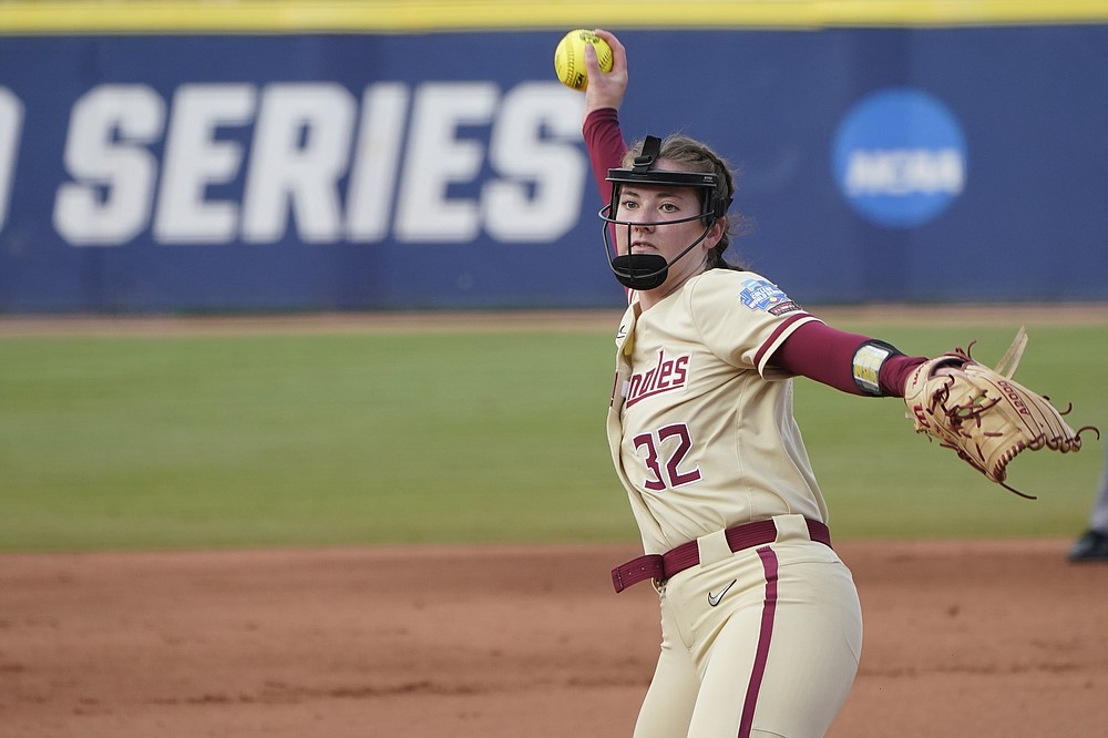 Florida State's Kathryn Sandercock pitches against Oklahoma in the first inning of the second game of the NCAA Women's College World Series softball championship series, Wednesday, June 9, 2021, in Oklahoma City. (AP Photo/Sue Ogrocki)
