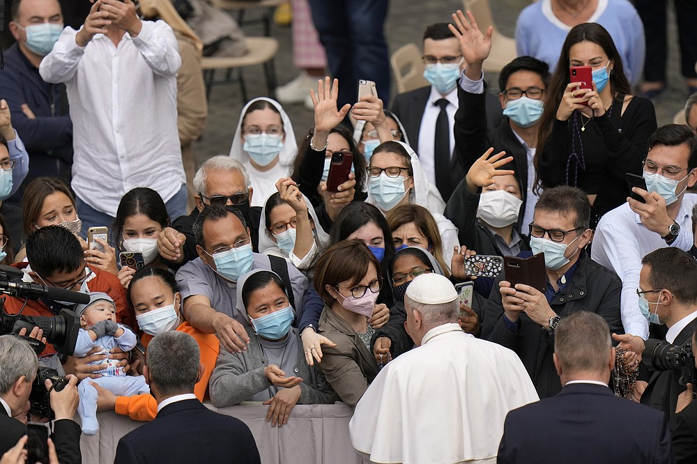 Pope Francis is greeted by faithful as he arrives for his weekly general audience, at the Vatican, Wednesday, June 9, 2021. (AP Photo/Alessandra Tarantino)