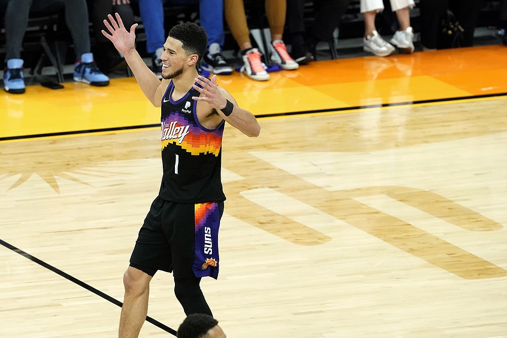 Phoenix Suns guard Devin Booker (1) celebrates during the second half of Game 2 of an NBA basketball second-round playoff series against the Denver Nuggets, Wednesday, June 9, 2021, in Phoenix. (AP Photo/Matt York)