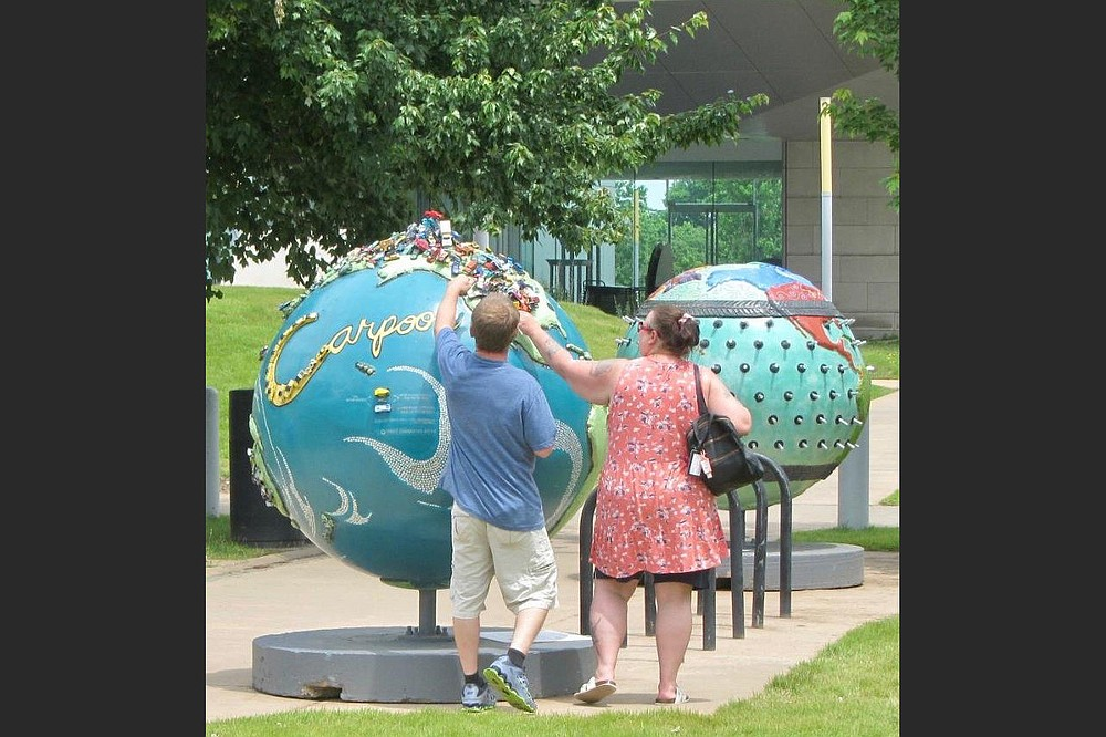 """The """"Cool Globes"""" exhibit includes Cheryl Steiger's """"Carpool"""" (left) and Derric Clemmons' """"Under Pressure."""" (Special to the Democrat-Gazette/Marcia Schnedler)"""