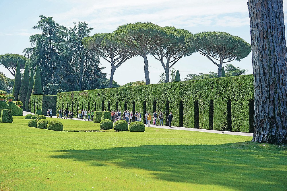 Visitors walk in the gardens of the Papal Palace, in Castel Gandolfo, some 30 kilometers southeast of Rome, Saturday, May 29, 2021. As Covid-19 restrictions are slowly being lifted in Italy, thousands of people are returning to see the extensive gardens and apartments at the Papal Palace of Castel Gandolfo in the Alban Hills near Rome, that for hundreds of years have been the summer retreat for Popes seeking to escape the suffocating heat of Rome. (AP Photo/Andrew Medichini)
