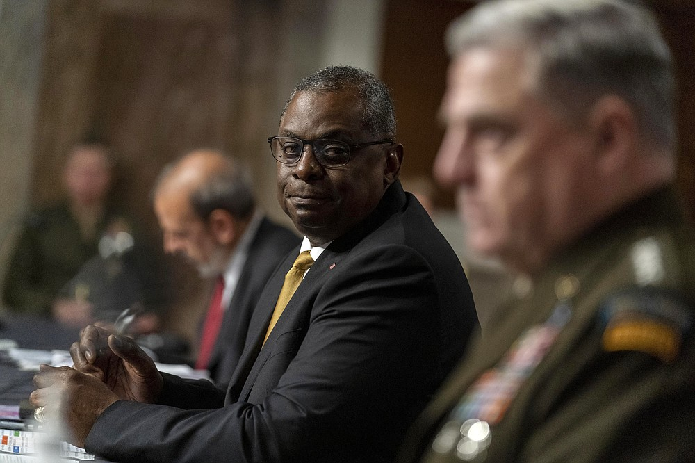Secretary of Defense Lloyd Austin, center, Chairman of the Joint Chiefs of Staff Gen. Mark Milley, right, and Defense Under Secretary Mike McCord, left, appear at a Senate Armed Services budget hearing on Capitol Hill in Washington, Thursday, June 10, 2021. (AP Photo/Andrew Harnik)