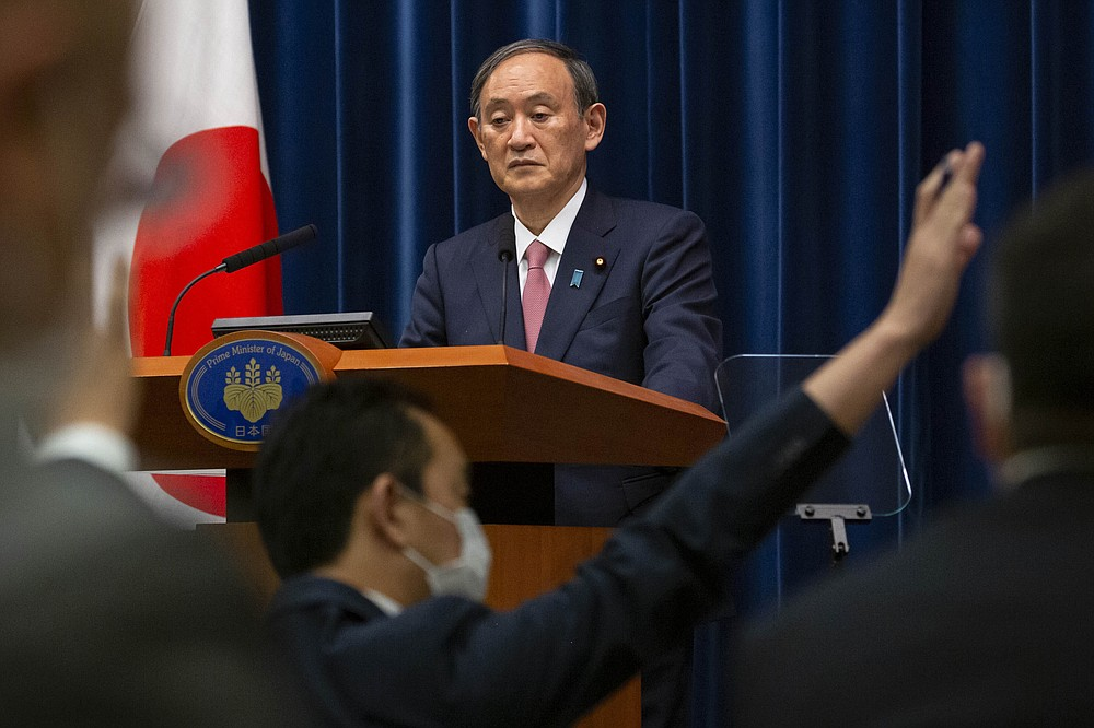 FILE - In this May 14, 2021, file photo, Japanese Prime Minister Yoshihide Suga speaks during a press conference at the prime minister's official residence, in Tokyo. Helping countries recover from the coronavirus pandemic will be at the top of the agenda for the Group of Seven summit when British Prime Minister Boris Johnson welcomes President Joe Biden and the leaders of France, Germany, Italy, Japan and Canada to the cliff-ringed Carbis Bay beach resort in southwestern England on Friday, June 11. It's a first G-7 summit for Biden and Suga, who took office in September. (Yuichi Yamazaki/Pool Photo via AP, File)