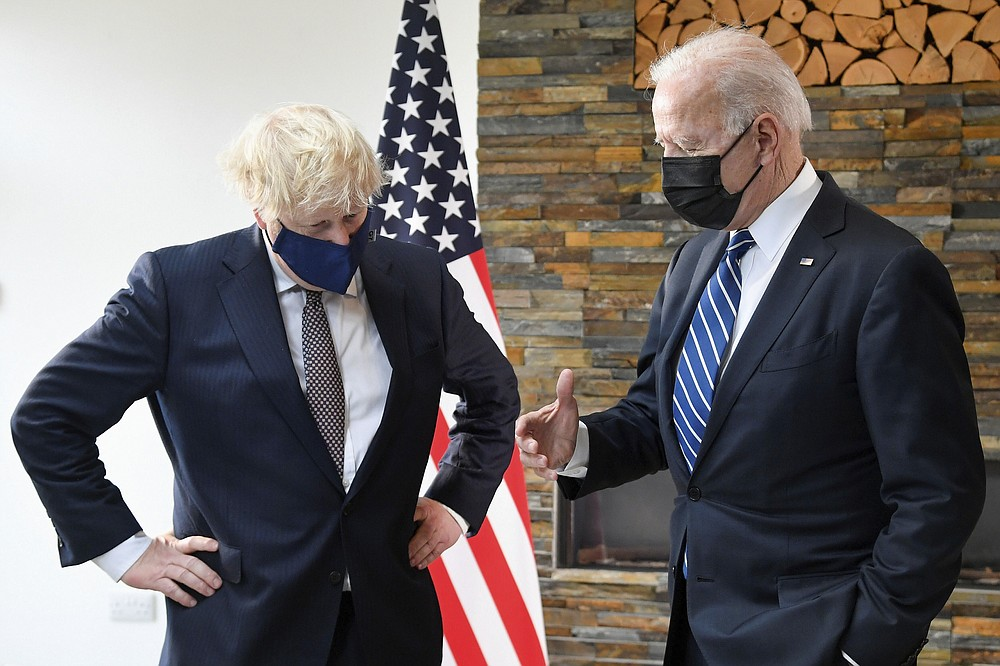 US President Joe Biden, right, talks with Britain's Prime Minister Boris Johnson, during their meeting ahead of the G7 summit in Cornwall, Britain, Thursday June 10, 2021. (Toby Melville/Pool Photo via AP)