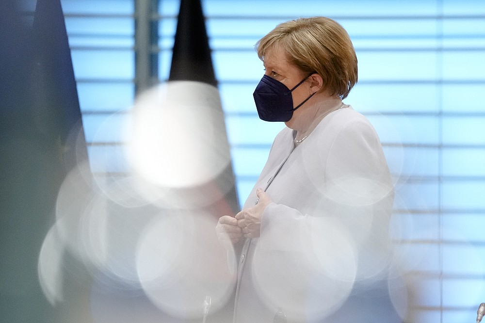 FILE - In this June 9, 2021, file photo, German Chancellor Angela Merkel arrives for the weekly cabinet meeting of the German government at the chancellery in Berlin, Germany. Helping countries recover from the coronavirus pandemic will be at the top of the agenda for the Group of Seven summit when British Prime Minister Boris Johnson welcomes President Joe Biden and the leaders of France, Germany, Italy, Japan and Canada to the cliff-ringed Carbis Bay beach resort in southwestern England on Friday, June 11. (AP Photo/Markus Schreiber, Pool, File)