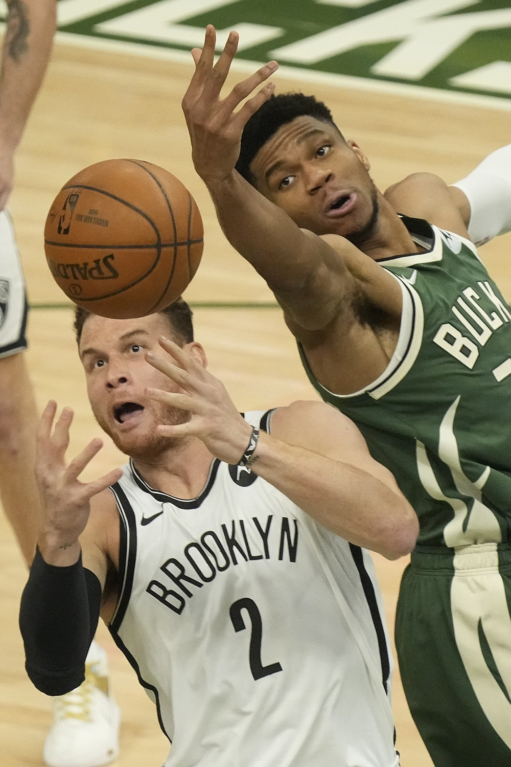 Brooklyn Nets' Blake Griffin and Milwaukee Bucks' Giannis Antetokounmpo go after a loose ball during the first half of Game 3 of the NBA Eastern Conference basketball semifinals game Thursday, June 10, 2021, in Milwaukee. (AP Photo/Morry Gash)