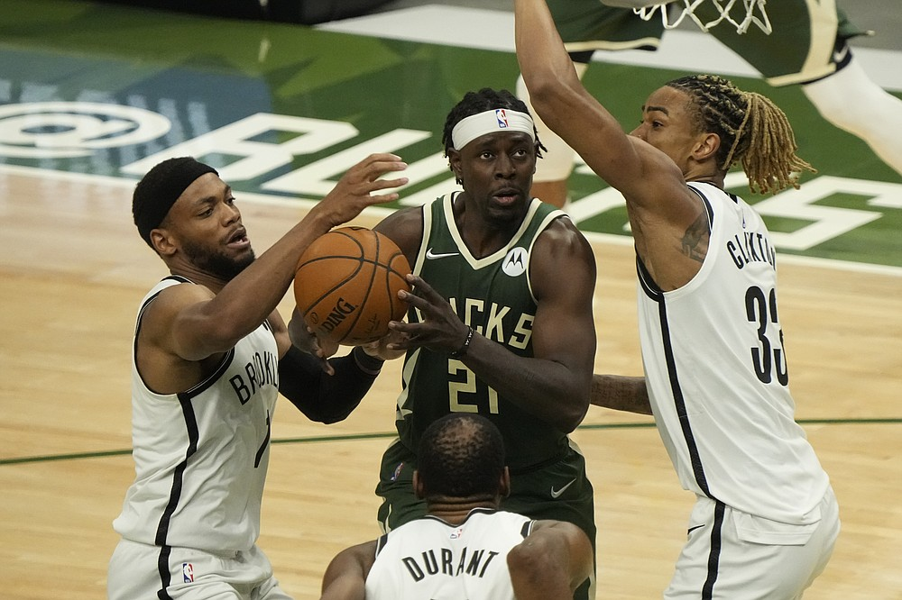 Milwaukee Bucks' Jrue Holiday tries to drive in traffic during the first half of Game 3 of the NBA Eastern Conference basketball semifinals game against the Brooklyn NetsThursday, June 10, 2021, in Milwaukee. (AP Photo/Morry Gash)