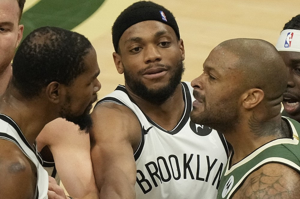 Brooklyn Nets' Bruce Brown tries to break up Kevin Durant and Milwaukee Bucks' Bryn Forbes during the second half of Game 3 of the NBA Eastern Conference basketball semifinals game Thursday, June 10, 2021, in Milwaukee. (AP Photo/Morry Gash)