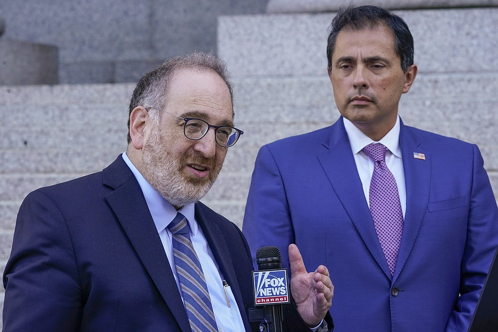 Alfredo Ortiz, right, president and CEO of the Job Creators Network, and Howard Kleinhendler, Job Creators Network attorney, speak to reporters, Thursday, June 10, 2021, in New York. A Manhattan judge has rejected an attempt to force Major League Baseball to return next month's All-Star Game to Atlanta. (AP Photo/Mary Altaffer)