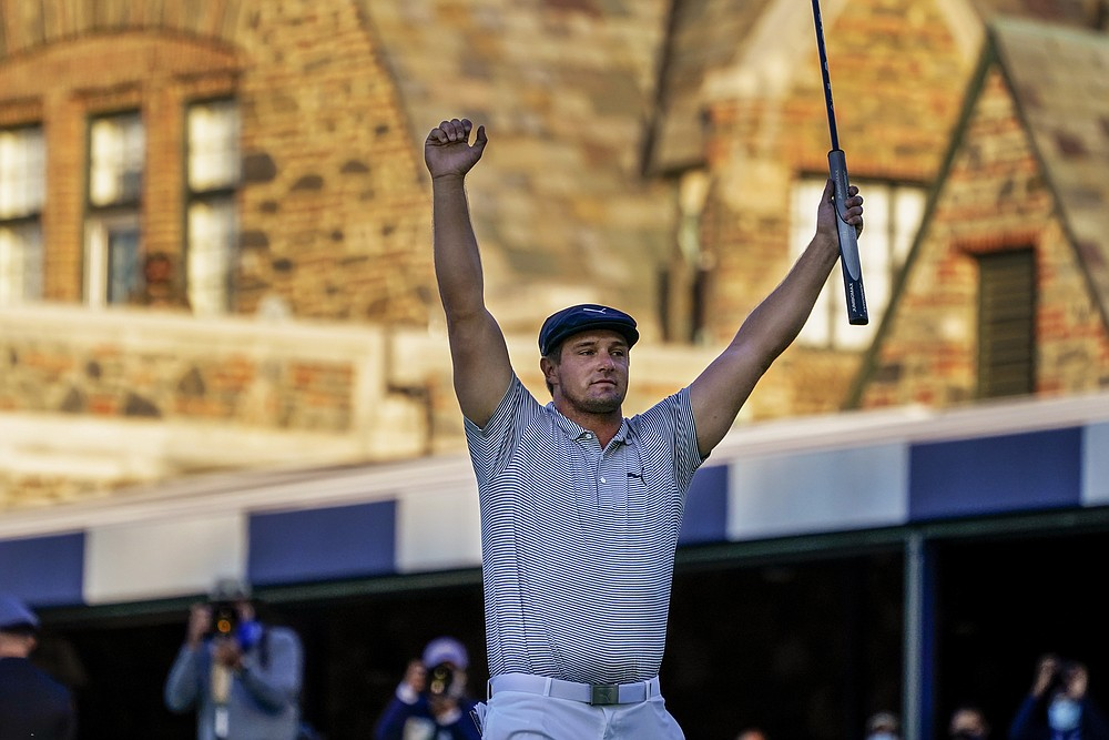 FILE - In this Sept. 20, 2020, file photo, Bryson DeChambeau, of the United States, reacts after sinking a putt for par on the 18th hole to win the U.S. Open golf tournament in Mamaroneck, N.Y. DeChambeau will try to win back-to-back on June 17-20 in the U.S. Open at Torrey Pines. (AP Photo/Charles Krupa, File)