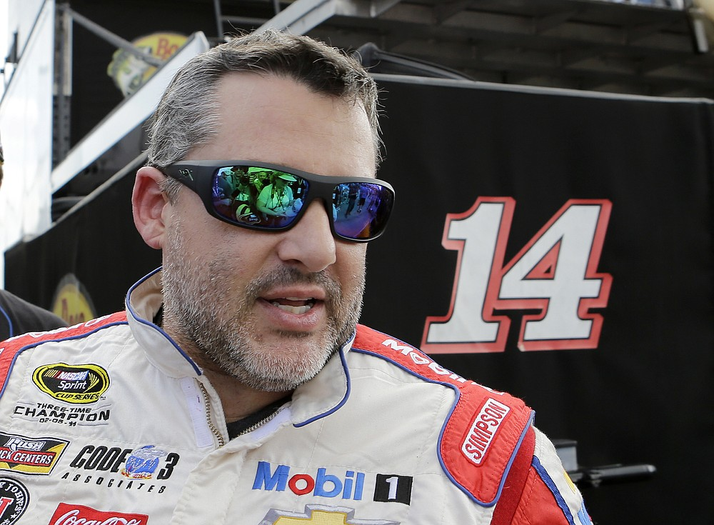 FILE - In this Nov. 19, 2016, file photo, Tony Stewart heads to the hauler after the NASCAR Sprint Cup Series Auto Racing practice in Homestead, Fla. Superstar Racing Experience was conceptualized as a series for former greats who still had the skills and desire to compete to square off in identically prepared cars at six of America's classic short tracks.  Ray Evernham and Tony Stewart took great care in extending invites to the made-for-TV league they had co-created and pulled in a dozen of the most iconic names in modern day motorsports. (AP Photo/Alan Diaz, File)