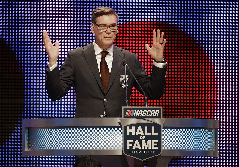 FILE - In this Jan. 19, 2018, file photo, Ray Evernham speaks after being inducted into the NASCAR Hall of Fame in Charlotte, N.C. Superstar Racing Experience was conceptualized as a series for former greats who still had the skills and desire to compete and square off in identically prepared cars at six of America's classic short tracks. Ray Evernham and Tony Stewart took great care in extending invites to the made-for-TV league they had co-created. They thoughtfully pulled in a a dozen of the most iconic names in modern day motorsports. (AP Photo/Chuck Burton, File)