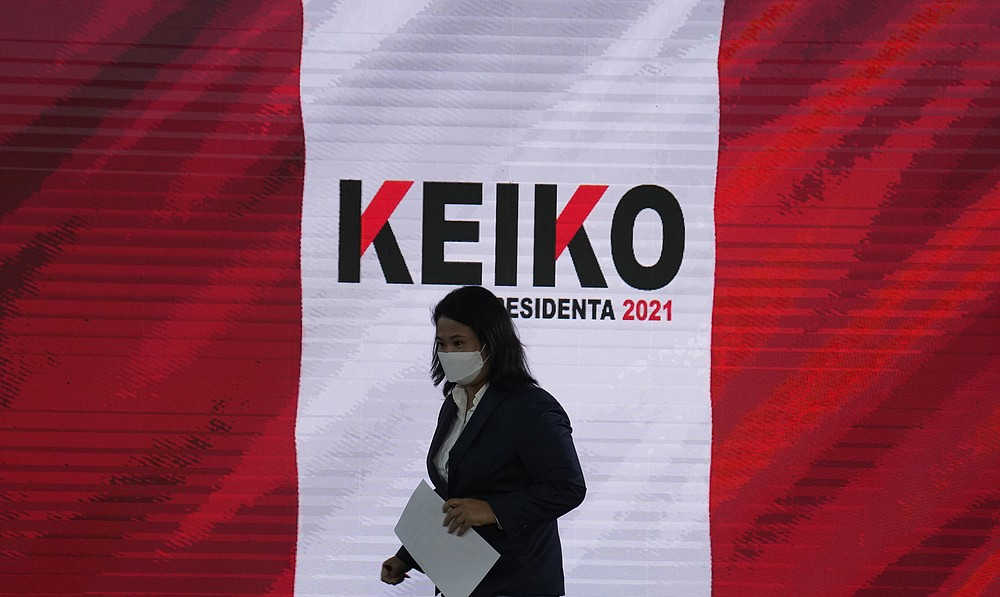 Presidential candidate Keiko Fujimori arrives for a press conference in Lima, Peru, Wednesday, June 0, 2021. Peruvians are still waiting to learn who will become their president next month as votes from Sunday's runoff election continued to be counted and the tiny difference between the two candidates, Fujimori and Pedro Castillo, has narrowed. (AP Photo/Martin Mejia)
