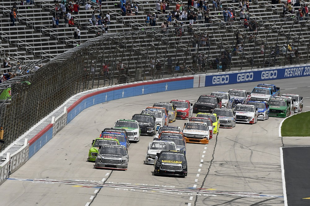 Drivers head into the front stretch as they get the green flag during a NASCAR Truck Series auto race at Texas Motor Speedway in Fort Worth, Texas, Saturday, June 12, 2021. (AP Photo/Larry Papke)