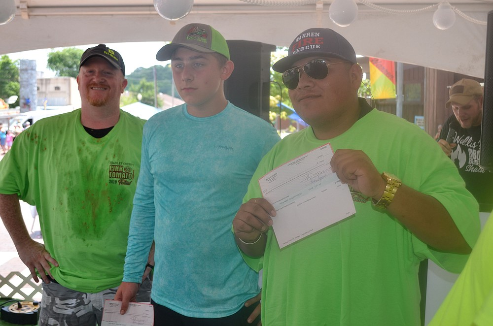 Professional category tomato eating contest 1st, 2nd and 3rd place winners (from left) Cody Gage, Gage Weaver and Steve Acuapa display their prizes. (Special to The Commercial/Richard Ledbetter)
