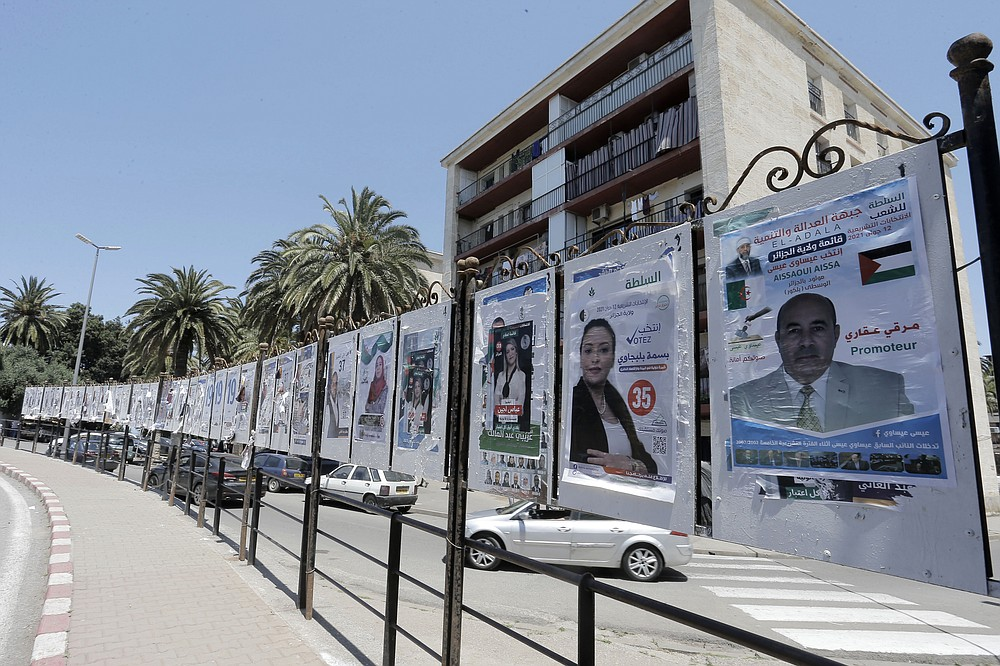 Electoral posters are pictured in Algiers, Wednesday, June 9, 2021. Algerians are preparing for the June 12 elections to elect members of parliament. (AP Photo/Toufik Doudou)