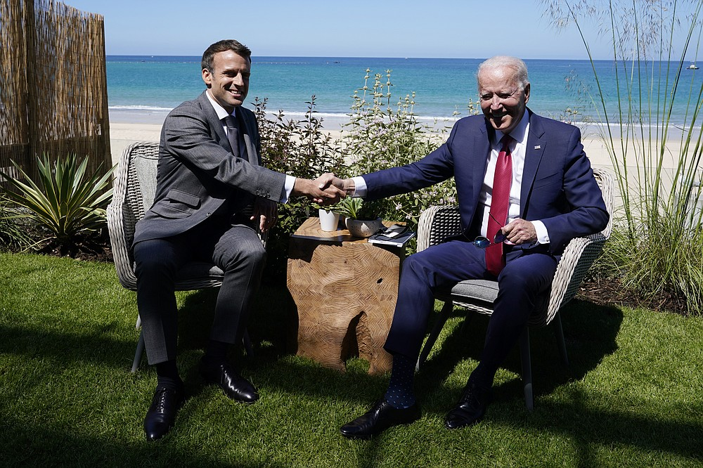 President Joe Biden and French President Emmanuel Macron visit during a bilateral meeting at the G-7 summit, Saturday, June 12, 2021, in Carbis Bay, England. (AP Photo/Patrick Semansky)