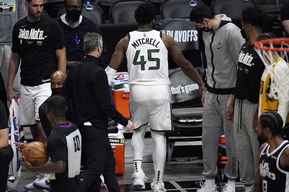 Utah Jazz guard Donovan Mitchell walks off the court with an injury during the second half of Game 3 of a second-round NBA basketball playoff series against the Los Angeles Clippers Saturday, June 12, 2021, in Los Angeles. (AP Photo/Mark J. Terrill)