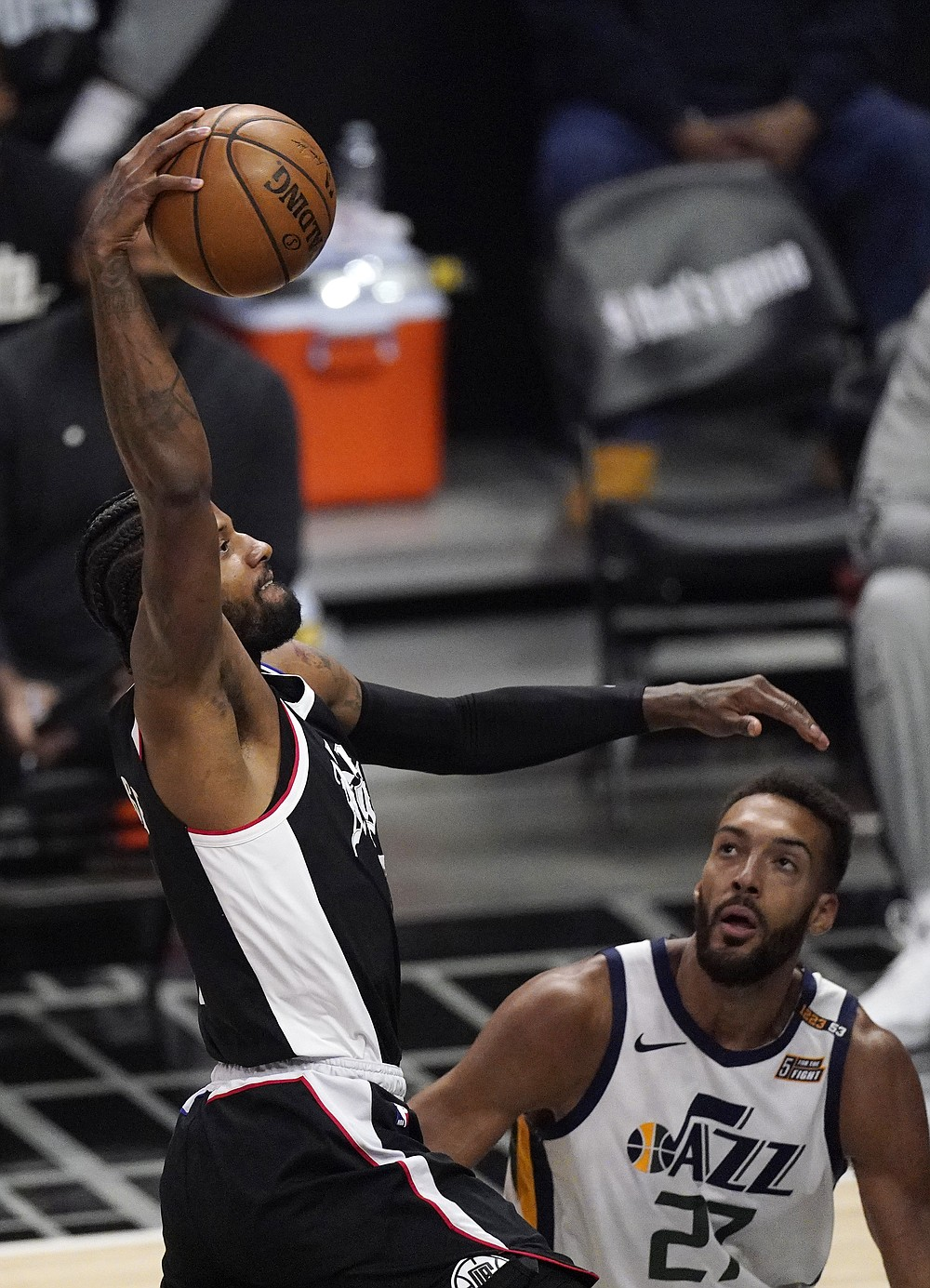 Los Angeles Clippers guard Paul George, left, dunks as Utah Jazz center Rudy Gobert watches during the second half of Game 3 of a second-round NBA basketball playoff series Saturday, June 12, 2021, in Los Angeles. (AP Photo/Mark J. Terrill)