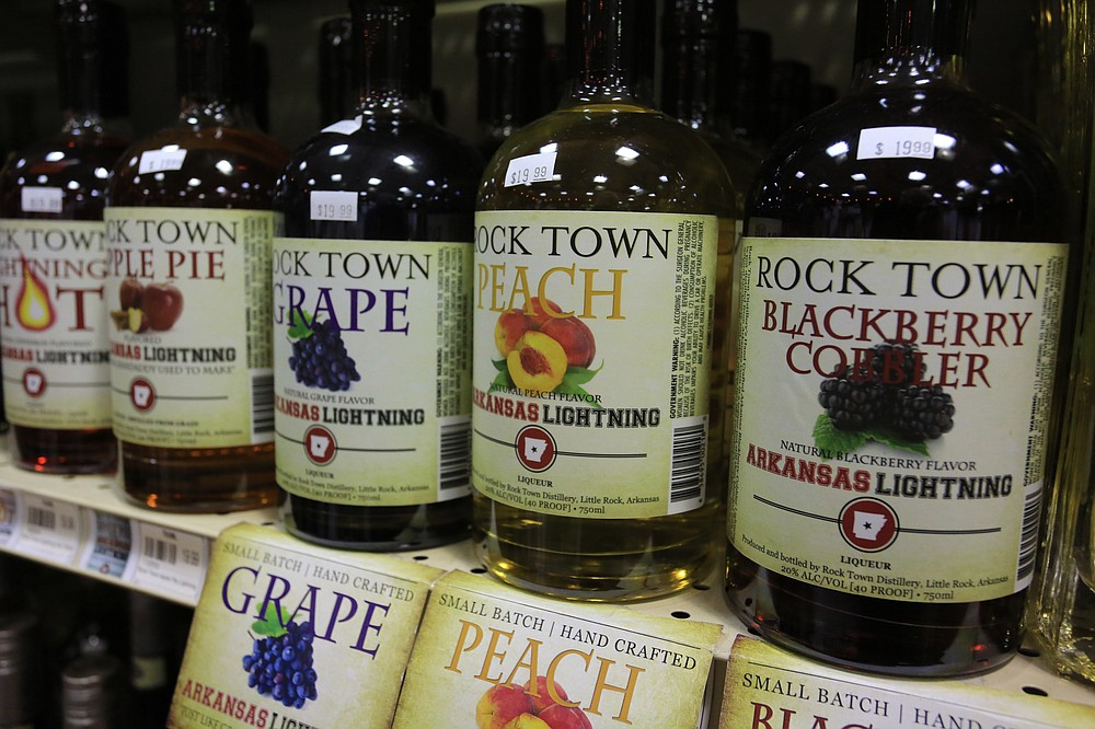 Selections of Arkansas Lightning, flavored moonshine liqueurs, at Little Rock's Colonial Wines and Spirits in 2014. (Democrat-Gazette file photo)