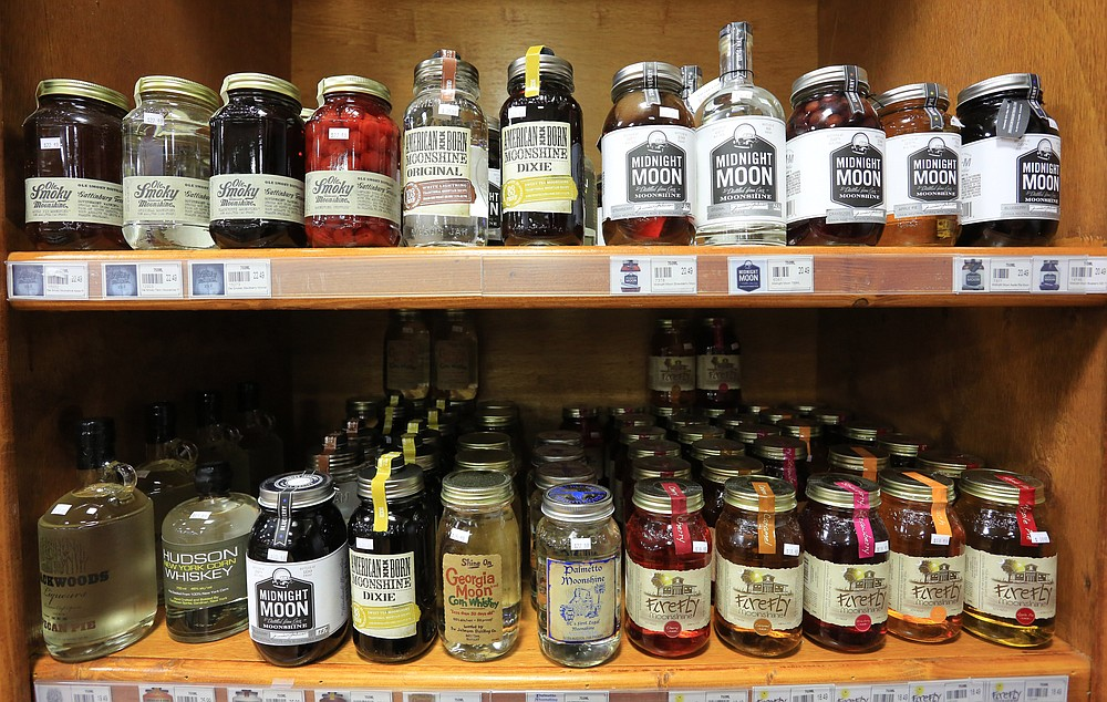 Selections of moonshine style liqueurs await buyers at Colonial Wines and Spirits in Little Rock in 2014. (Democrat-Gazette file photo)
