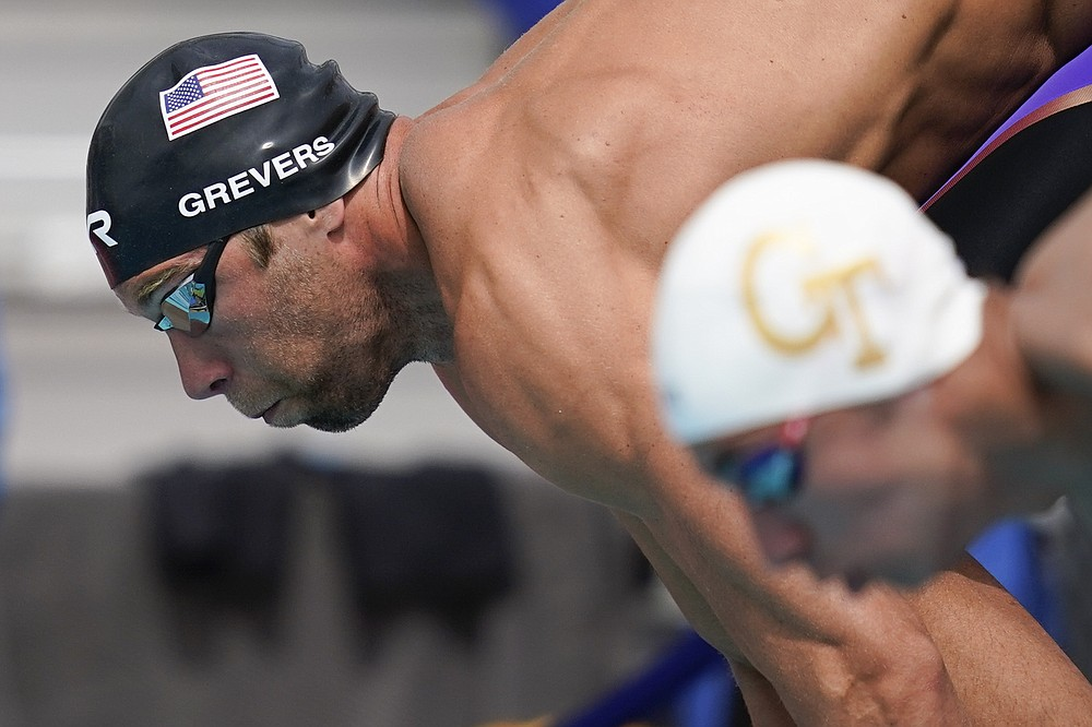 FILE - In this Sunday, April 11, 2021 file photo, Matt Grevers dives in to the pool at the start of the men's 100-meter freestyle final at the TYR Pro Swim Series swim meet in Mission Viejo, Calif. (AP Photo/Ashley Landis, File)