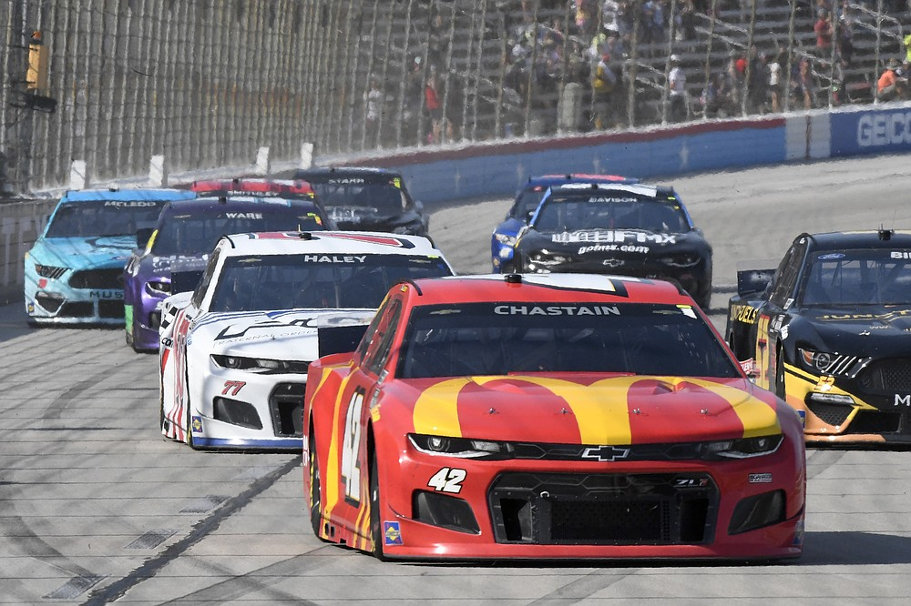 Ross Chastain (42) leads the field into Turn 1 during the NASCAR All-Star Open Cup series auto race at Texas Motor Speedway in Fort Worth, Texas, Sunday, June 13, 2021. (AP Photo/Larry Papke)
