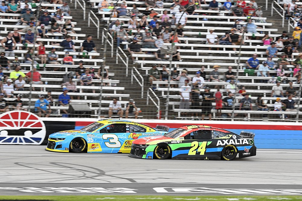 William Byron (24) and Austin Dillon (3) compete for position down the front stretch during the NASCAR Cup Series All-Star auto race at Texas Motor Speedway in Fort Worth, Texas, Sunday, June 13, 2021. (AP Photo/Larry Papke)
