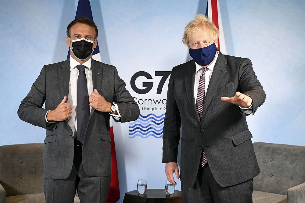 Britain's Prime Minister Boris Johnson, right, and French President Emmanuel Macron ahead of a bilateral meeting during the G7 summit in Cornwall, England, Saturday June 12, 2021. (Stefan Rousseau/Pool via AP)